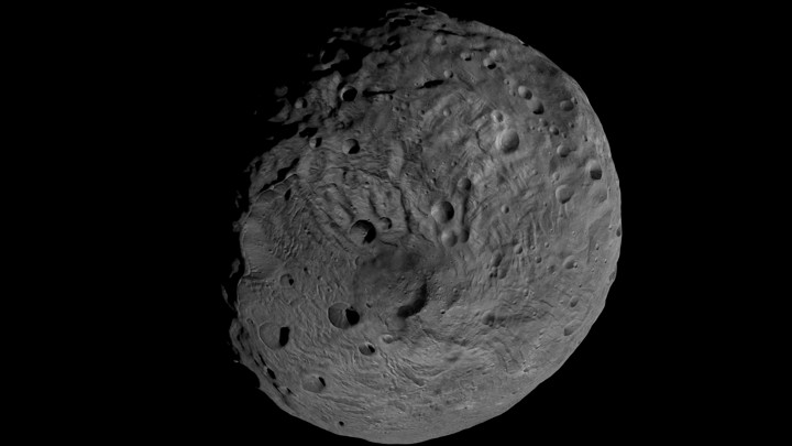 Vesta, a rocky asteroid orbiting between between Mars and Jupiter