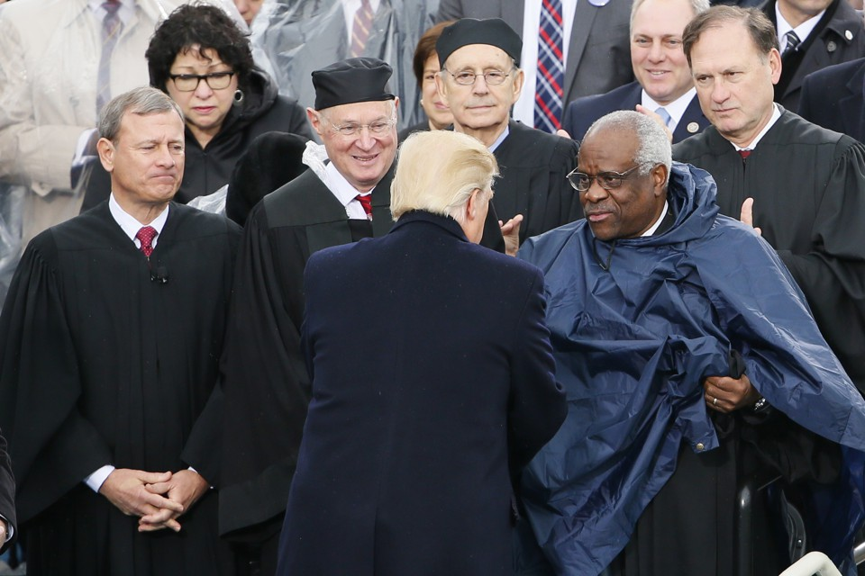 Donald Trump greets members of the Supreme Court at his inauguration.