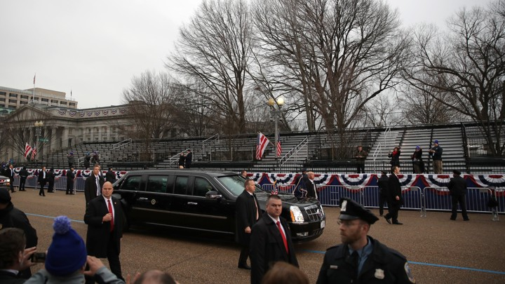President Trump's limousine passes an empty reviewing stand during the inaugural parade.