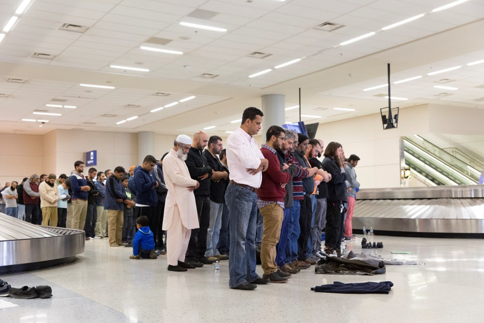 people gather in prayer at dallasforth worth airport on sunday laura buckman reuters