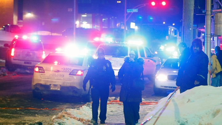 Police officers are seen near a mosque after a shooting in Quebec City on January 29, 2017.