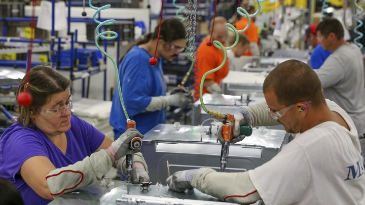 Workers at Whirlpool in Cleveland, Tennessee assemble appliances. Appliance manufacturing is one of the most concentrated industries in the U.S.