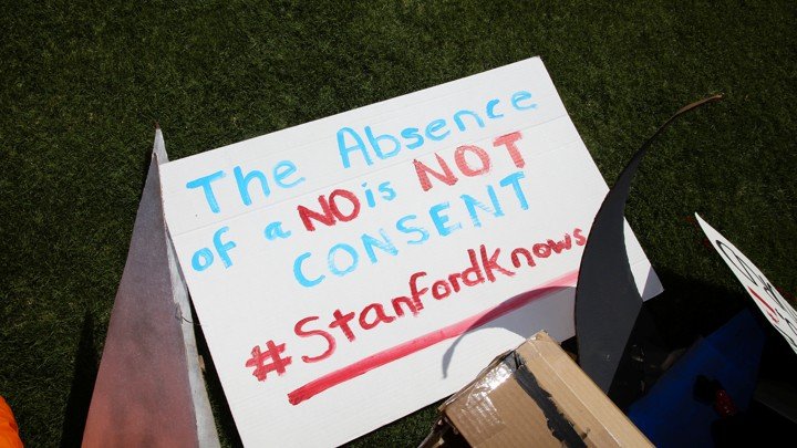 "A sign reads ""The absence of no is not consent. #Stanfordknows"""