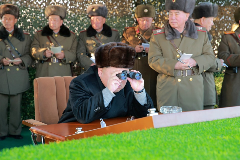 North Korean leader Kim Jong Un guides a firing contest among multiple launch rocket system batteries.