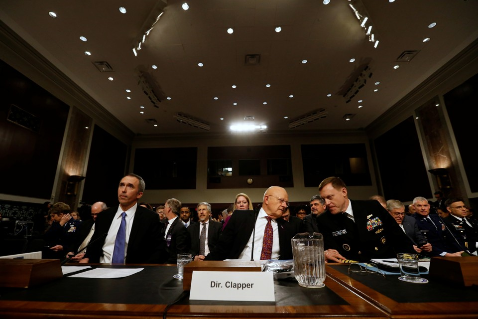 U.S. Defense Under Secretary for Intelligence Marcel Lettre, Director of National Intelligence James Clapper, and National Security Agency Director U.S. Navy Admiral Michael Rogers testify before a Senate Armed Services Committee hearing on foreign cyber threats.