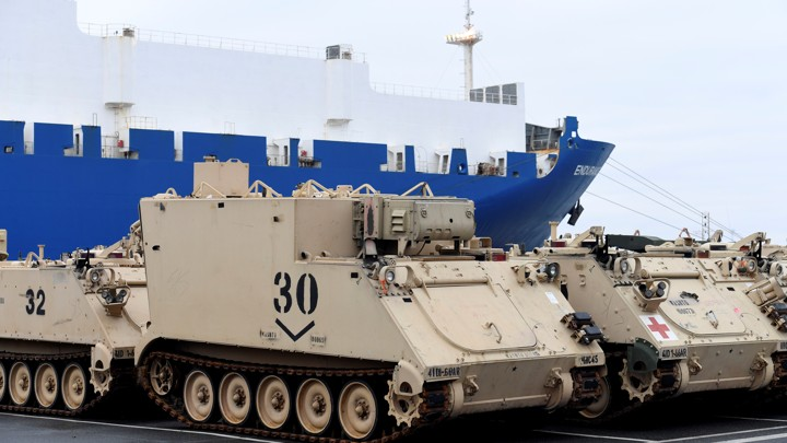 U.S. tanks and other military equipment being unloaded in the German port of Bremerhaven