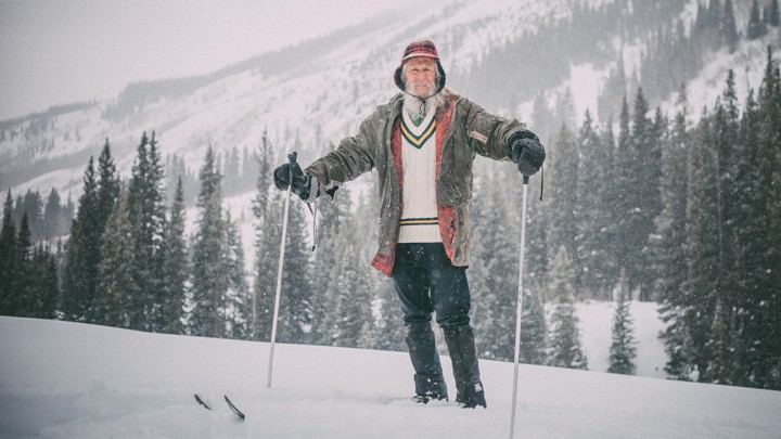 Billy Barr stands in the snow at his home below Gothic Mountain