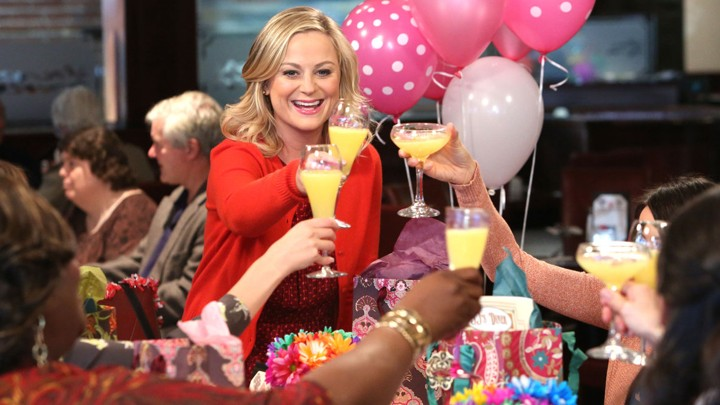 Leslie Knope toasting friends with mimosas
