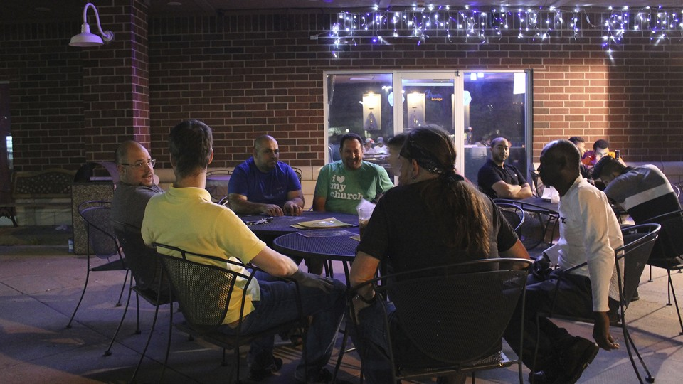 Nashwaan Saddoon, Amjad Arafeh, Shane Lakatos, and other men participate in a monthly Sawa gathering in Toledo, Ohio.