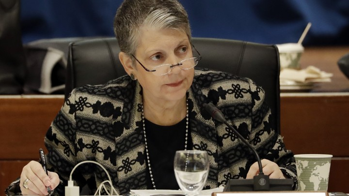 The University of California president is shown looking at someone at a Board of Regents meeting earlier this year.
