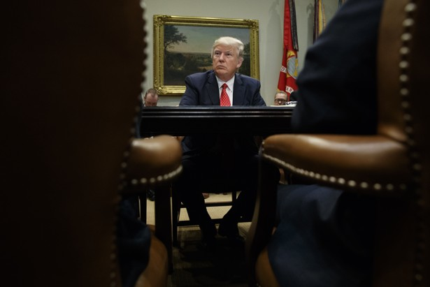 President Donald Trump listens during a meeting with county sheriffs in the Roosevelt Room of the White House.