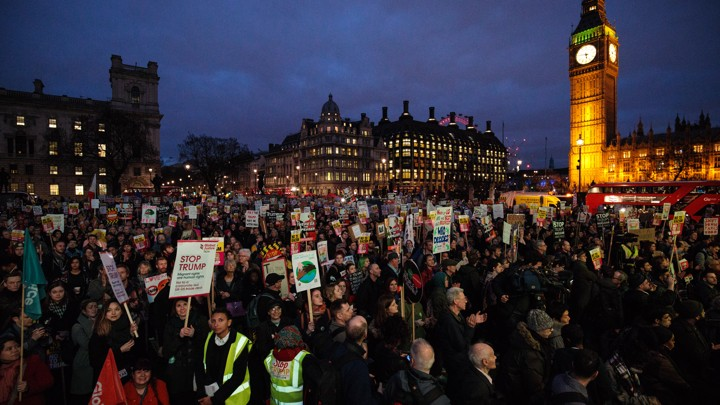 Thousands of protesters holding placards take part in a rally in Parliament Square against President Donald Trump's state visit to the U.K.