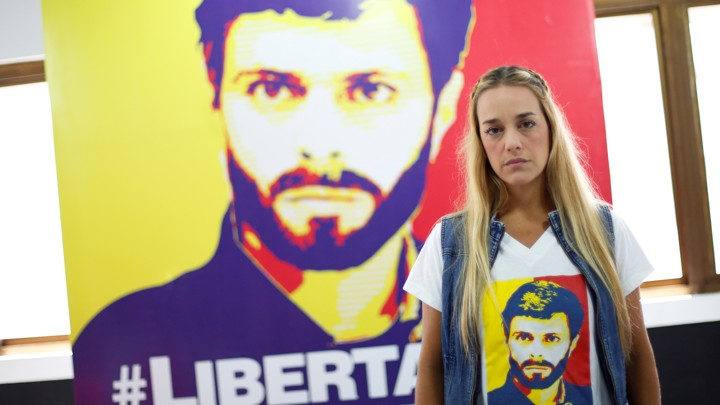 Lilian Tintori, wife of jailed Venezuelan opposition leader Leopoldo Lopez, poses for a picture in front of a poster depicting her husband.