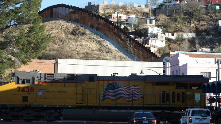 A freight train crosses into the U.S. across the border with Mexico in Nogales.