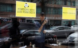"""A store displays signs in its windows supporting the """"A Day Without Immigrants"""" strike on February 16."""