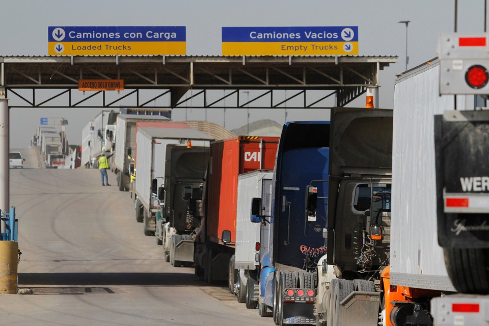 Trucks wait in a long queue for border customs control to cross into the U.S. at the Otay border crossing in Tijuana, Mexico.