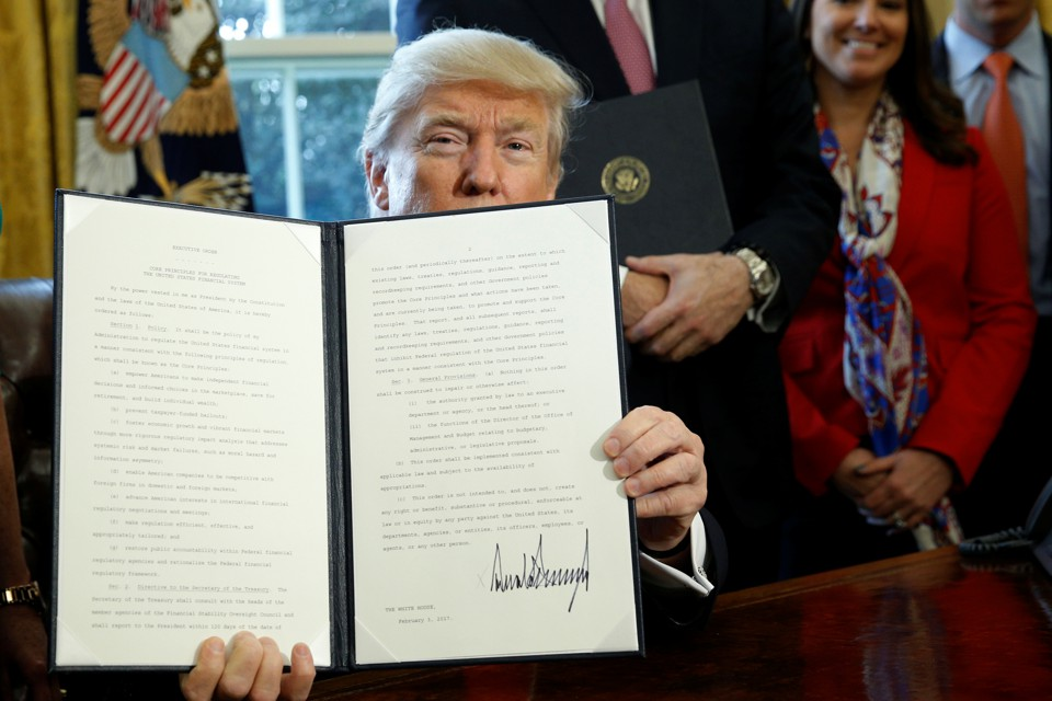President Trump holds an executive order related to financial regulation.
