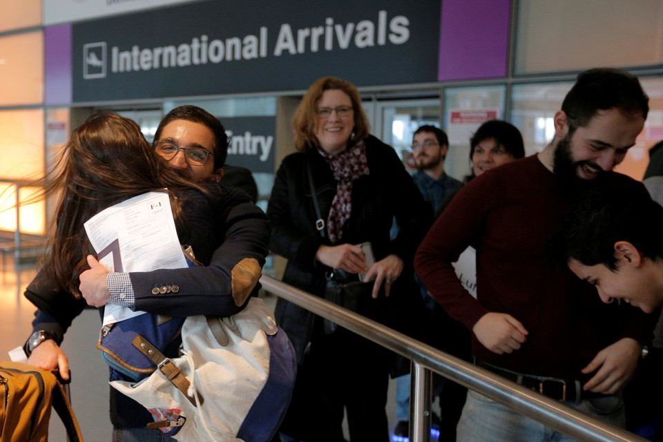 Behnam Partopour, a student from Iran, is greeted by his sister Bahar at Logan Airport after he cleared U.S. customs and immigration on an F1 student visa in Boston.