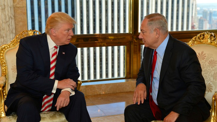 Israeli Prime Minister Benjamin Netanyahu speaks to Republican U.S. presidential candidate Donald Trump during their meeting in New York on September 25, 2016.