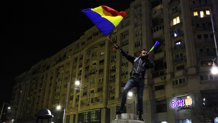 A protester waves Romanian flag during a demonstration in Bucharest, Romania.