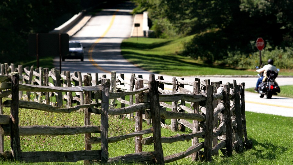 Trumps budget blueprint seeks to defund the appalachian regional a motorcyclist rides past a split rail fence on the blue ridge parkway near linville north carolina the scenic parkway is on a new driving tour map malvernweather Choice Image