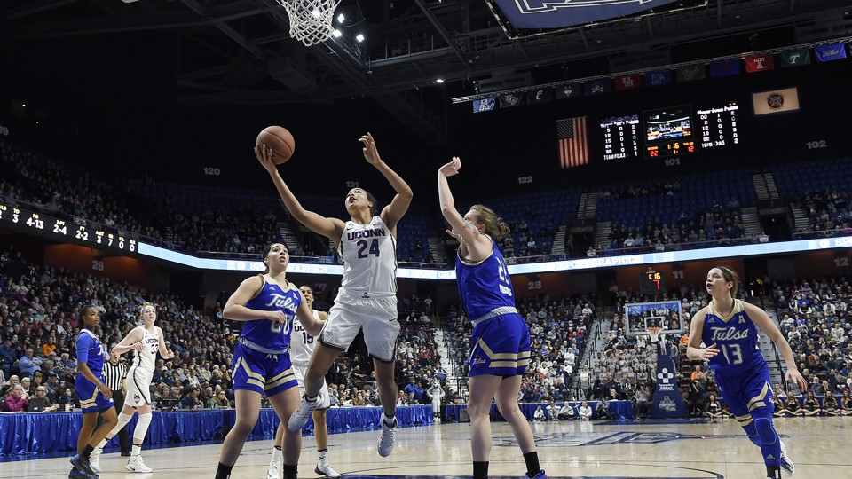 Connecticut's Napheesa Collier, center, splits Tulsa's defense during the first half of an NCAA college basketball game in the American Athletic Conference tournament quarterfinals.