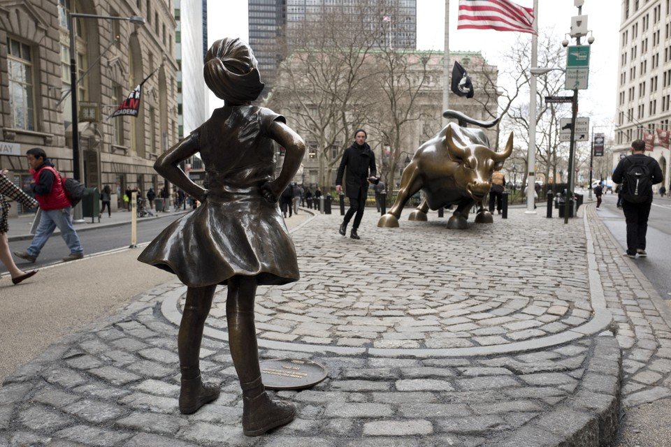 "The ""Fearless Girl"" statue faces down Wall Street's famous Charging Bull."