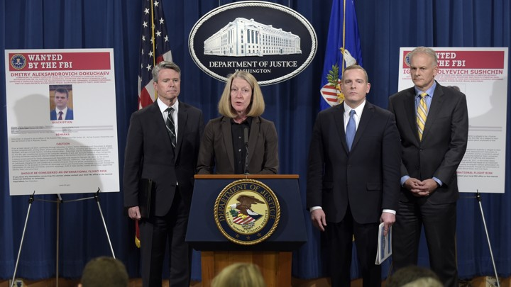 The Justice Department announced charges against four defendants, including two officers of Russian security services, for a mega data breach at Yahoo.