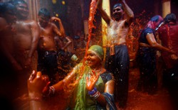 "A man throws water on a woman during ""Huranga,"" a game played between men and women a day after Holi, near Mathura, India."