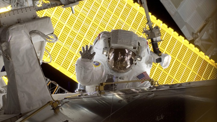 Astronaut Nicole Stott waves during a spacewalk outside the International Space Station in 2009.