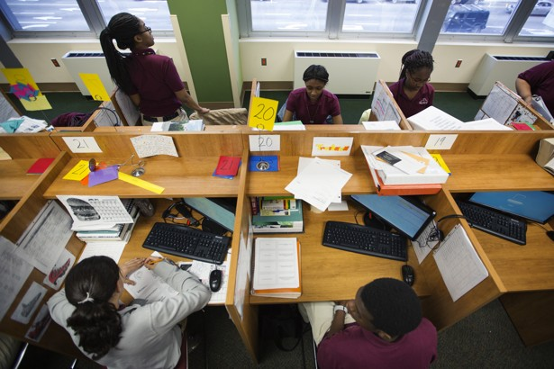 An overhead shot of students working on computers
