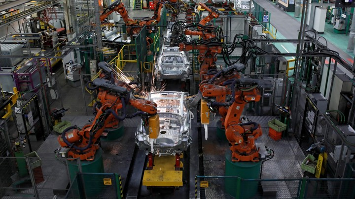 Robots put together cars at a factory in France.