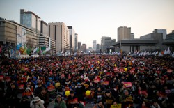 People attend a protest against South Korean President Park Geun Hye.