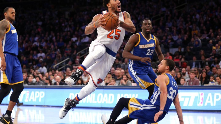 Derrick Rose (25), a point guard for the New York Knicks, drives against Stephen Curry (30) and Draymond Green (23) of the Golden State Warriors on March 5.