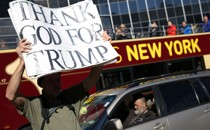 A man holds a pro-Trump sign in New York.