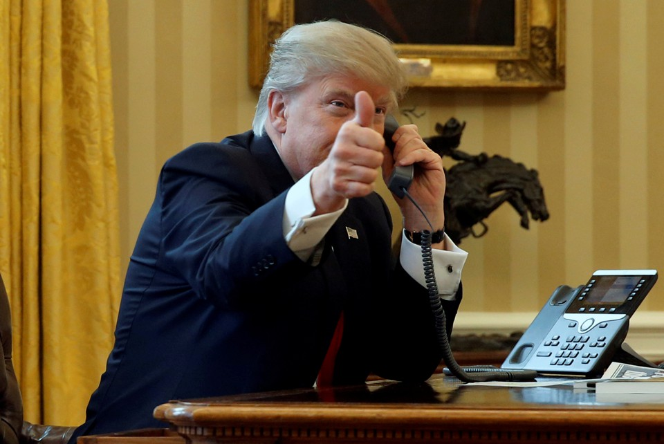 President Donald Trump gives a thumbs-up as he waits to speak by phone with Saudi Arabia's King Salman.