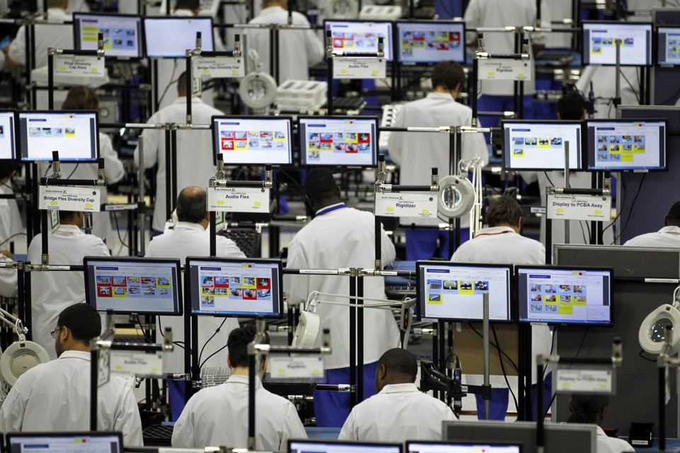 Workers in Fort Worth, Texas assemble Motorola phones at the Flextronics plant.