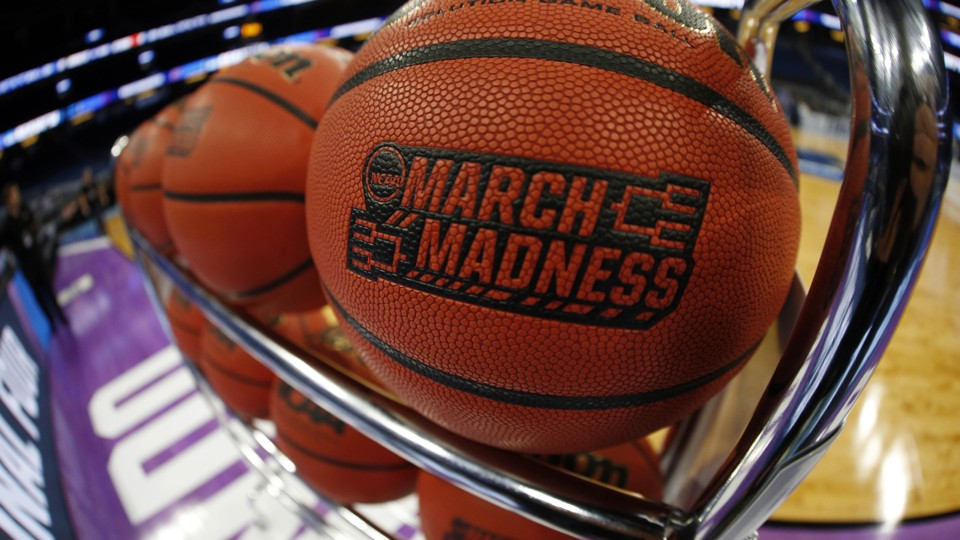 A rack of basketballs branded with the NCAA's March Madness logo