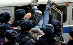 Police officers detain an opposition supporter during a rally in Vladivostok, Russia.