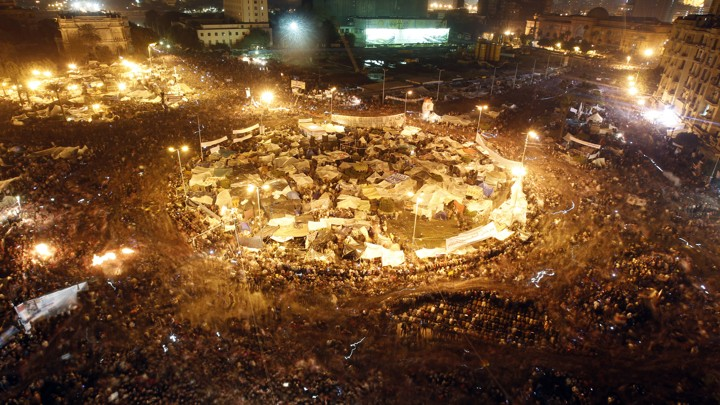 Anti-government protesters celebrate inside Tahrir Square after the announcement of Egyptian President Hosni Mubarak's resignation in Cairo February 11, 2011.