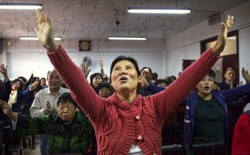 A Chinese Christian woman sings during a prayer service at an underground Protestant church in Beijing.