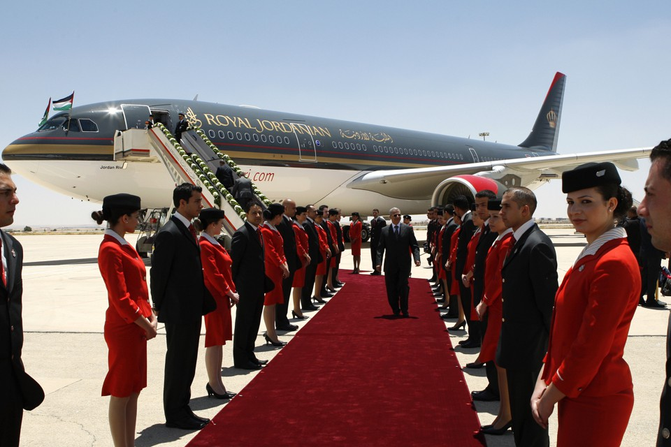 Flight attendants participate in a special ceremony after new aircrafts are acquired by Royal Jordanian.