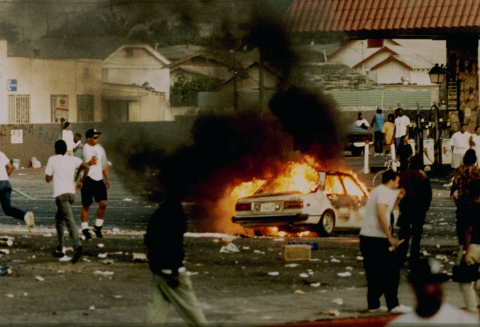 A car burns at the intersection of Florence and Normandie Avenues, which is considered the flashpoint of the L.A. Riots in 1992.