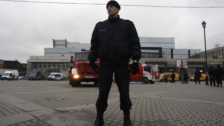 A riot police officer guards the area next to the entrance to Sennaya Square metro station in Saint Petersburg on April 3, 2017.