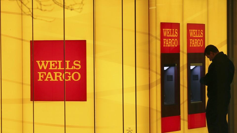 A man uses a Wells Fargo ATM.