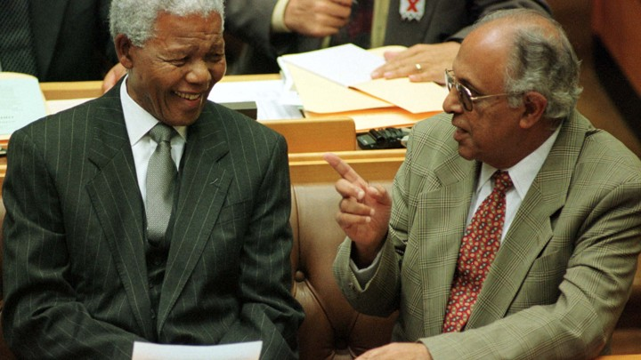 President Nelson Mandela talks to fellow veteran politician Ahmed Kathrada.