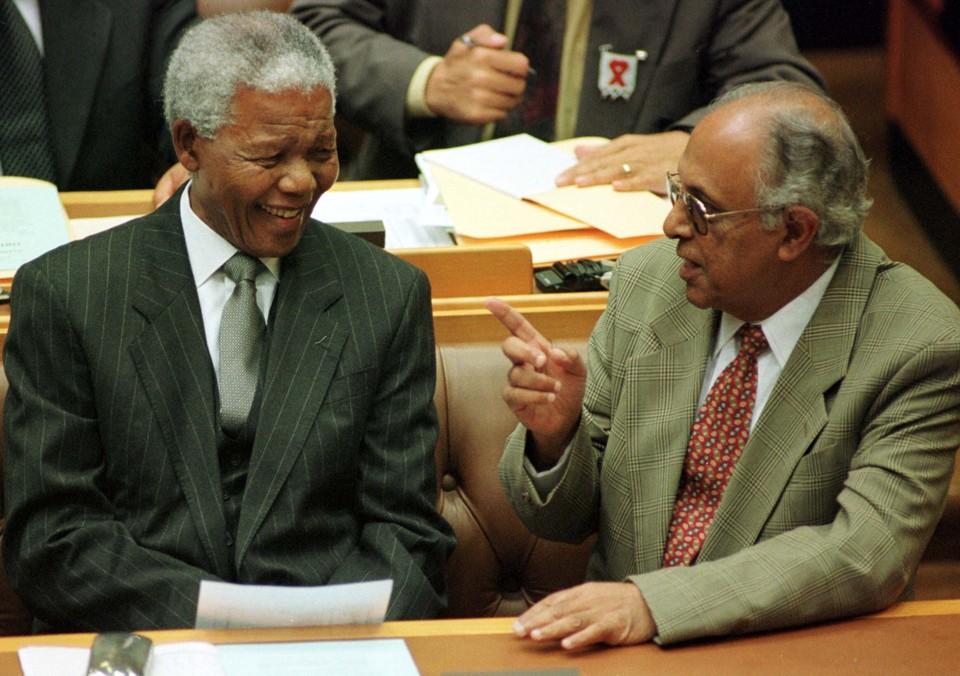 President Nelson Mandela talks to fellow veteran politician Ahmed Kathrada.