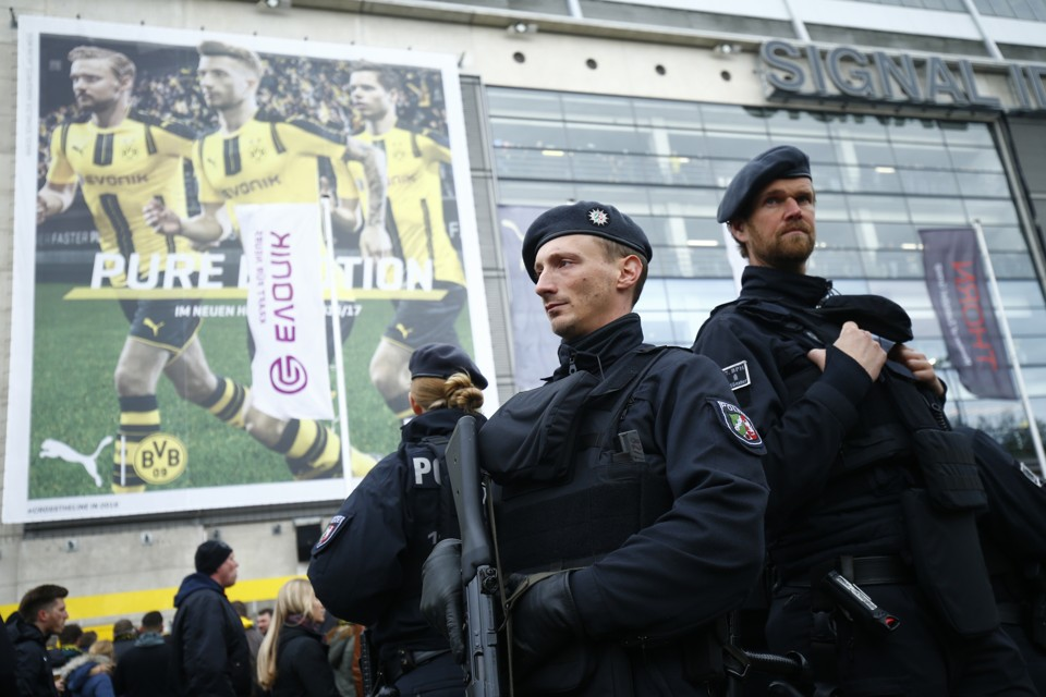 A view of security guards outside the stadium before the match between Borussia Dortmund and Eintracht Frankfurt.