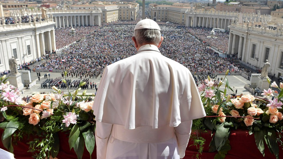 """Pope Francis delivers his """"Urbi et Orbi"""" message from the balcony overlooking St. Peter's Square at the Vatican April 16, 2017."""