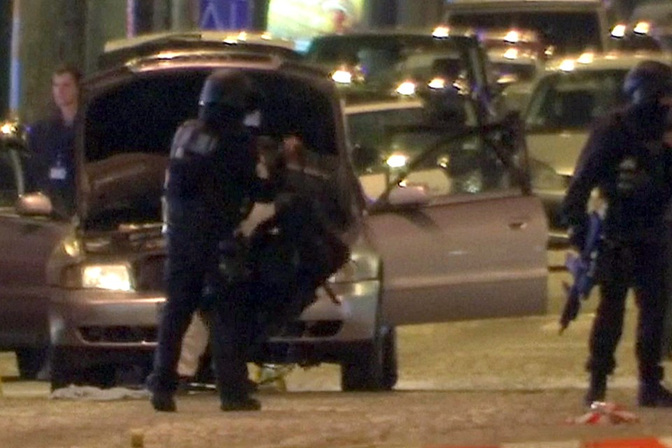 Police stand near the car used by the attacker on the Champs Elysees in Paris on April 20.